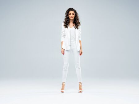 Portrait of a beautiful businesswoman wearing a pure white suit