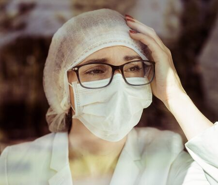 Portrait of a member of medical staff being tired of epidemic