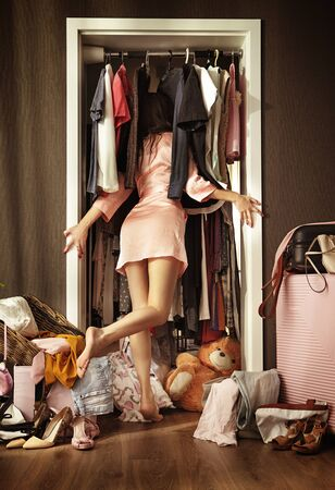 Conceptual picture of an elegant woman looking in the wardrobe Imagens - 145127225