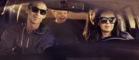 Portrait of the cheerful family during the car journey Imagens - 145127226