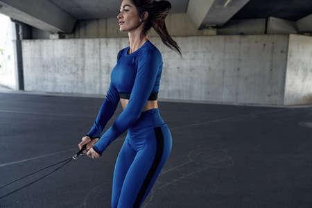 Portrait of a brunette woman wearing a modern training tracksuit
