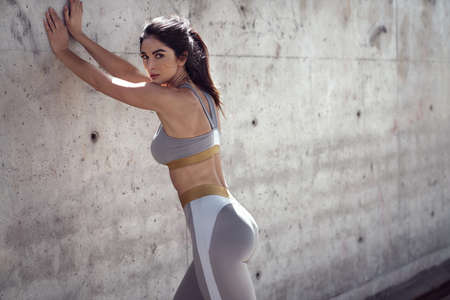 Pretty and athletic woman doing the body stretching