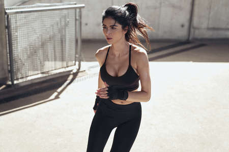 Attractive brunette lady doing the urban boxing workout