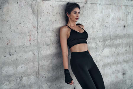 Athletic woman resting after exhausting running workout