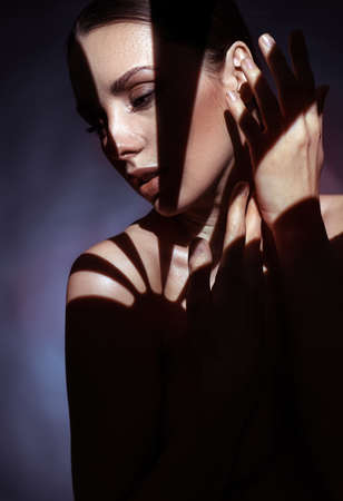 Closeup portrait of brunette woman hiding in shade