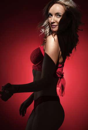 Portrait of an alluring blonde wearing the red, lace underwear 免版税图像