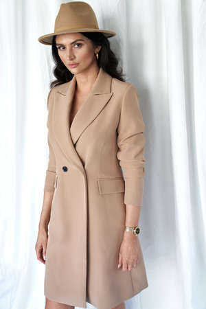 Attractive brunette lady wearing trendy, vernal coat