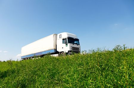 moving truck: White truck driving on the road Stock Photo