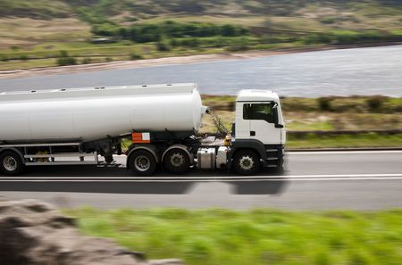 fuel truck: Tanker truck on blurred road Stock Photo