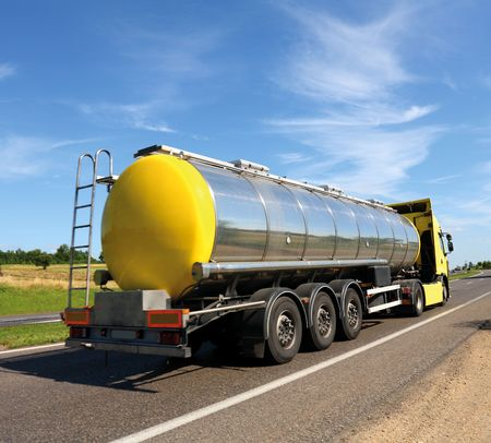 semitruck: Big fuel gas tanker truck on highway