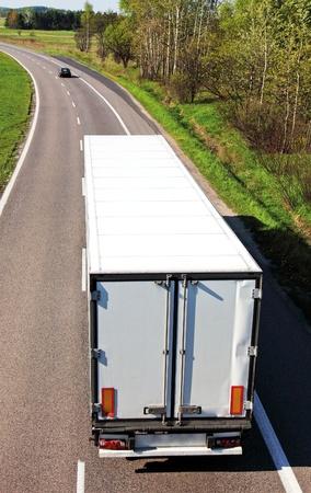 White truck on asphalt road  photo