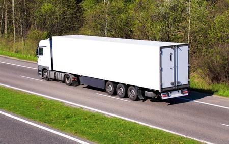 White truck on asphalt road
