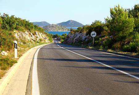 Winding road by the Adriatic sea, Croatia photo