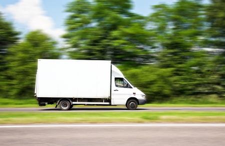 Speeding Van with blank advertisement space Stock Photo