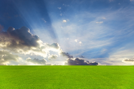 Green field and beautiful sky photo