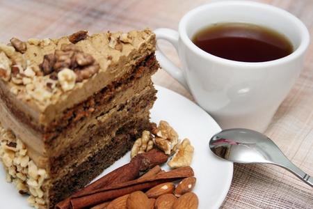 Drinking tea with nut pie photo