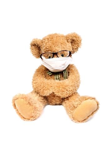 Virus risico, besmettelijke gevaar, Teddy beer met masker