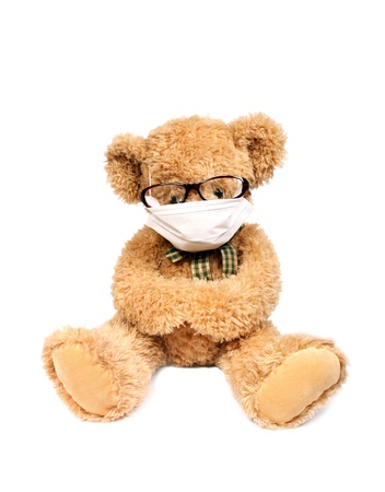 doctor toys: Virus risk, contagious danger,Teddy bear with mask Stock Photo
