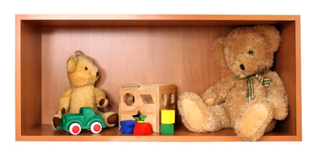 Cute bears on the wooden toy shelf photo