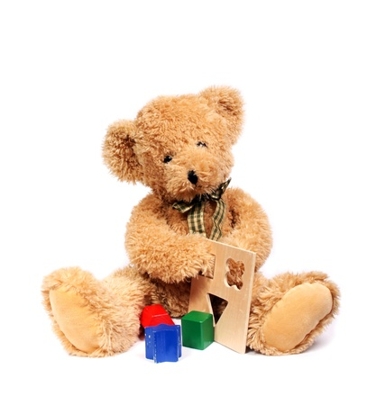 Teddy bear with wooden toys Stock Photo