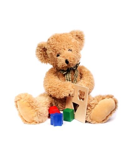 Teddy bear with wooden toys 版權商用圖片