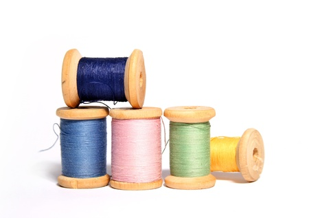 silvered: Isolated spools of colored threads  Stock Photo