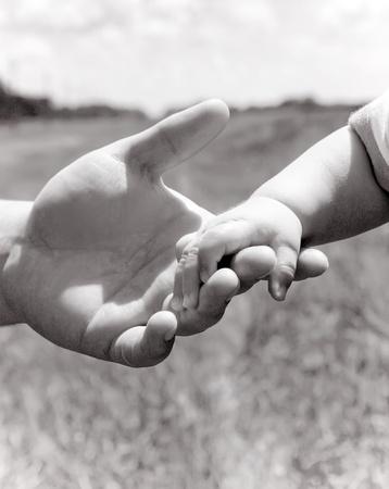 Parent holding little hand photo