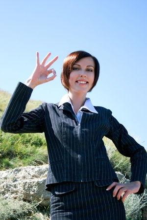 Young caucasian business lady with okay photo