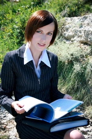 associate: Young caucasian business lady with folders Stock Photo