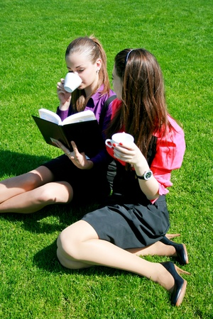 Two students relaxing on the grass Stock Photo - 10306660
