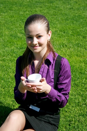 Student drinking tea at the park Stock Photo - 10305797