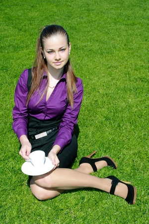 Young businesswoman with cup of tea Stock Photo - 10325926
