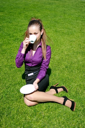 Young businesswoman drinking tea Stock Photo - 10325925