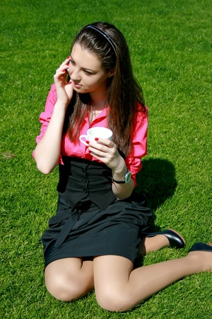 Young businesswoman drinking tea and talking photo