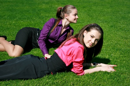 Young businesswomen relaxing on the grass Stock Photo - 10336701