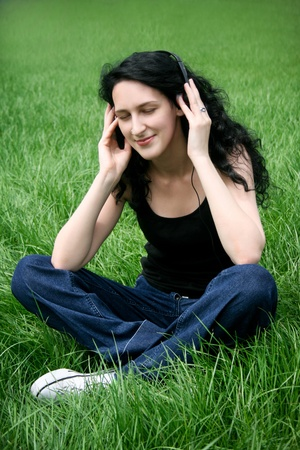 Teen girl listening music Stock Photo - 10519621