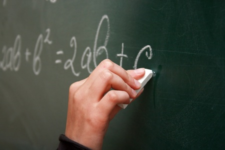 Writing at the chalkboard