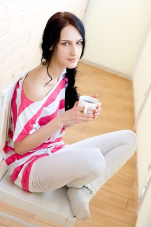 Caucasian young woman with cup of tea photo