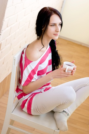 Caucasian young woman with cup of tea