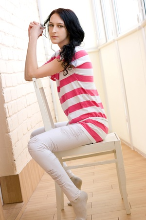 Caucasian young woman relaxing on the chair photo