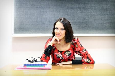 Young caucasian woman near the blackboard