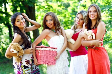 Four pretty young caucasian women in the park