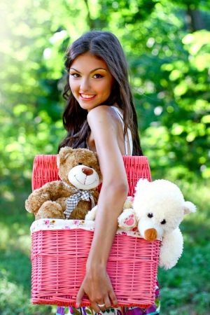 Pretty young caucasian woman in the park with toys photo