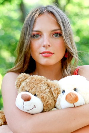 Pretty caucasian young woman with toys photo