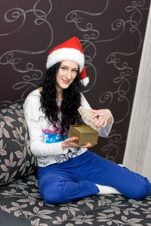 Caucasian girl in santa hat with gift photo