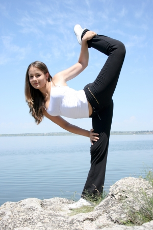 Young caucasian woman doing yoga exercises photo