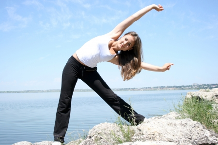 Young caucasian woman doing fitness exercises photo