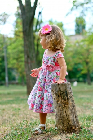Caucasian little girl walking in the park photo