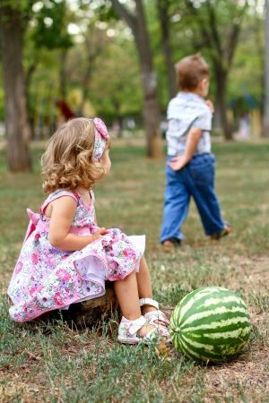 Boy and girl with watermelon