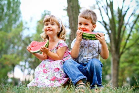 Boy and girl with watermelon photo